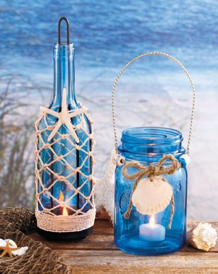 Beach seaside blue glass mason jar bottle candle holder with nautical decor.