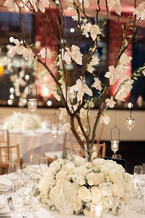 Glamorous and affordable centerpieces with crystal details, romantic candles, and unbelievably beautiful flowers.