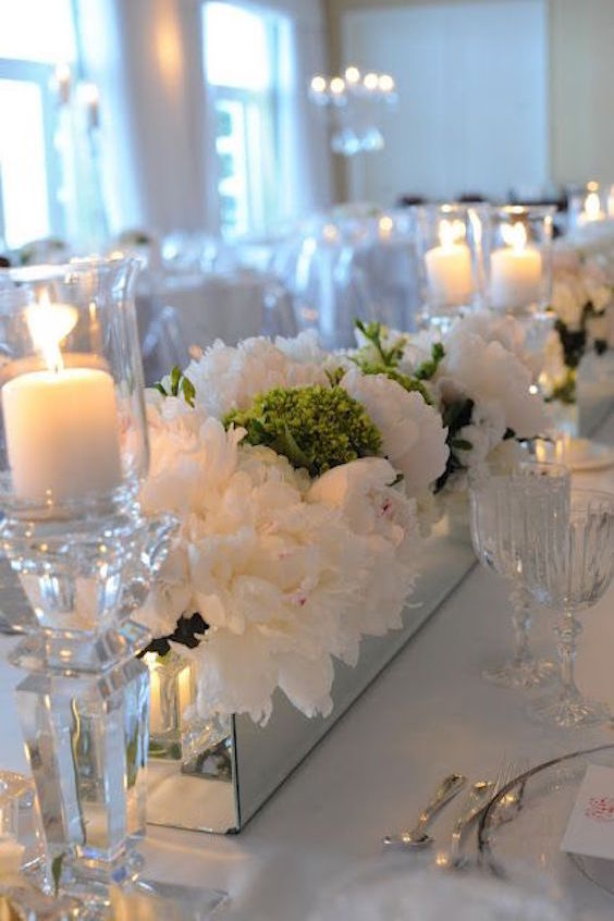 Simple flowers with mirrors and candles by Michelle Quance Photography.