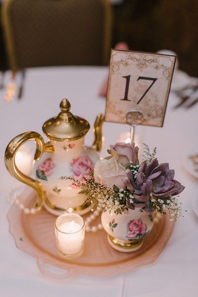 Vintage inspired simple wedding centerpieces at a Wisconsin Hotel reception.