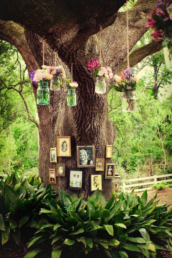 Old pictures of family members who have passed on as a tribute. Rustic Louisiana Wedding.