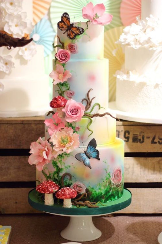 Woodland magical themed 3D wedding cake with painted butterflies by Sweet as Sugar.