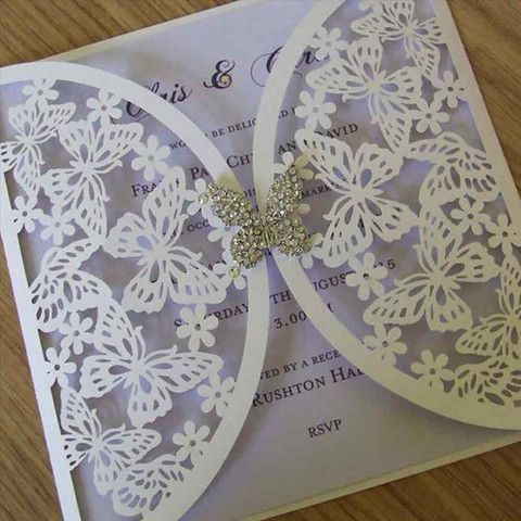 Laser cut butterfly wedding invitations in sweet lilac.