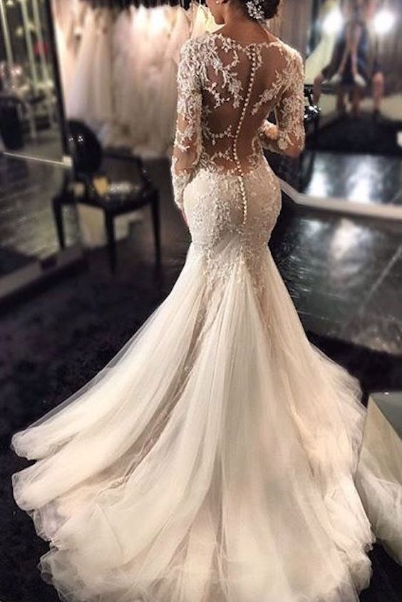 Romantic and sexy wedding dresses with long sleeves and a lace beaded sheer back.