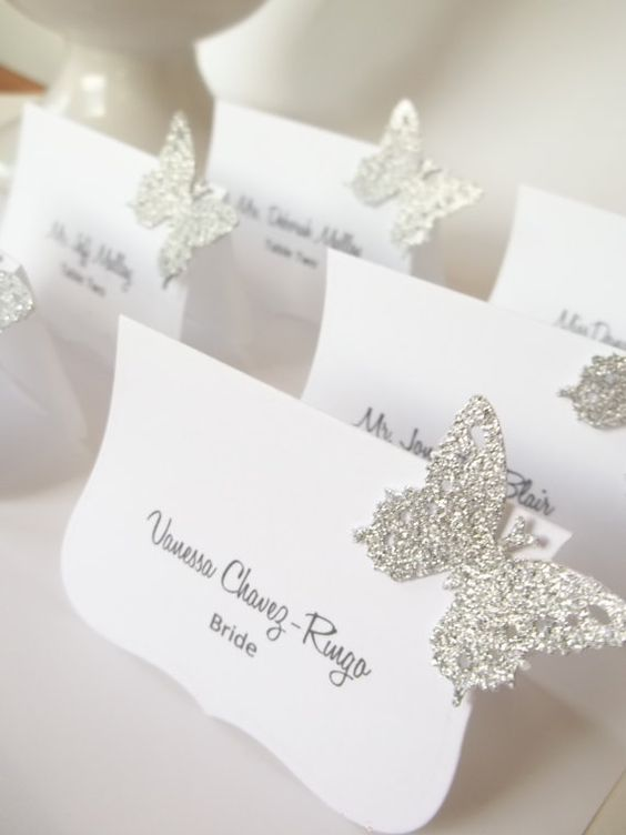Glue some glitter butterflies to your reception cards to spice them up.