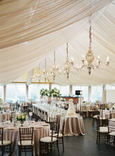This modern nautical Newport wedding features a large rectangular head table and round tables for the guests.