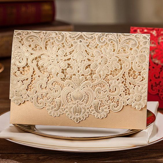 Laser cut wedding invites in gold.