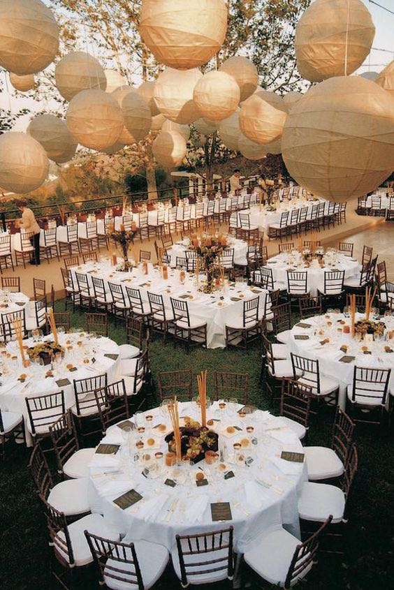 Unique layout for a wedding: festive Alfresco dining in California captured by Jon Barber.