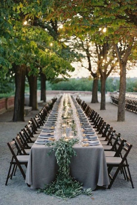 Outdoor reception with simplistic beauty and long rectangular tables.