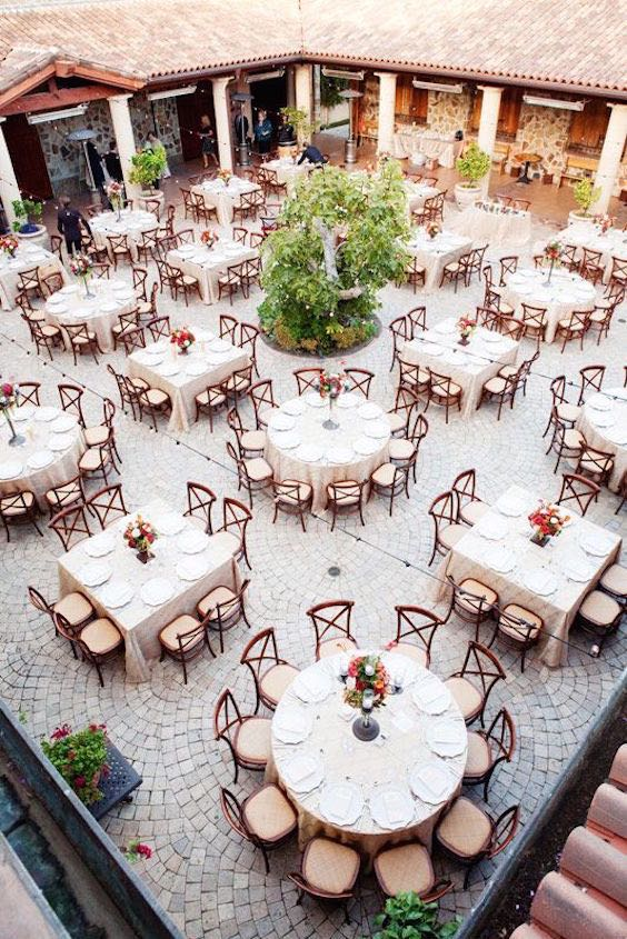 Mix round and square tables for an original reception seating plan. Photo credit: Janae Shields Photography.