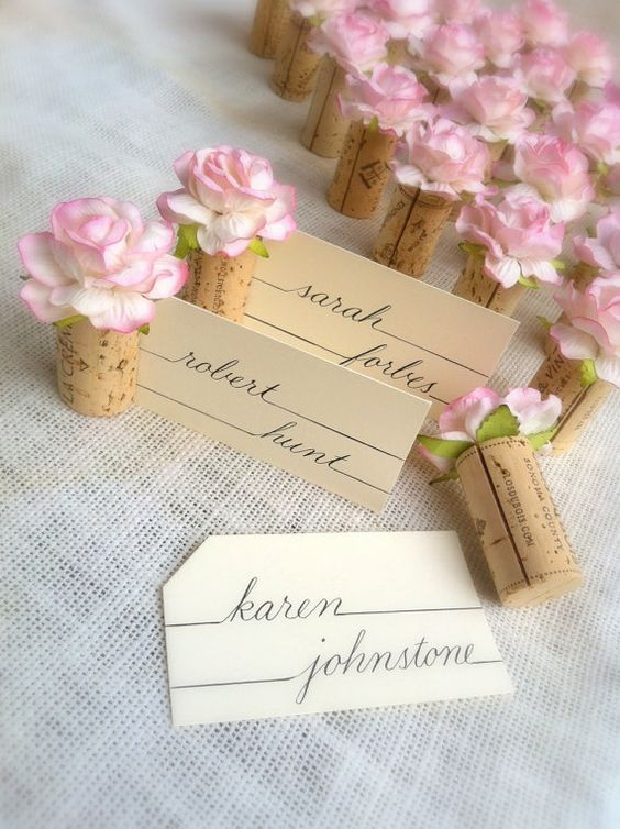 A wonderful idea for economic and cute place card holders. A rose on a wine cork.