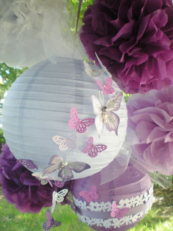 Purple pom poms and paper lanterns radiant orchid with hand-painted butterflies.