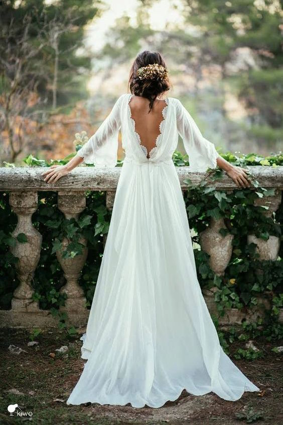 Boho or vintage and definitely romantic wedding dress.
