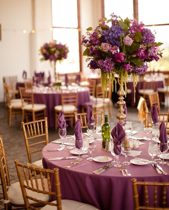 Gorgeous lavender magenta wedding and examples of wedding reception seating arrangements for round tables.