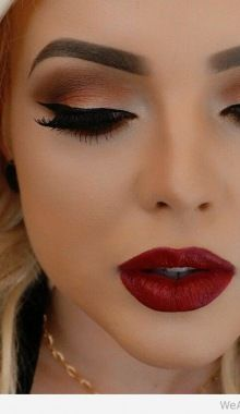 Awesome cat aye makeup matched with ruby red lips.