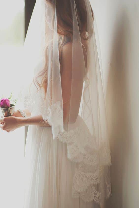 Fingertip veil with blusher. Dreamy Mountain Lodge wedding in fuchsia and mint.