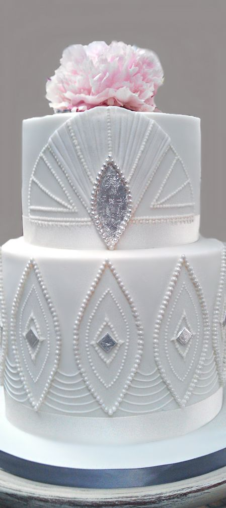 If a geometric decadent cake is what you're wanting for a wedding cake, then go no further than this stunning art deco white wedding cake.