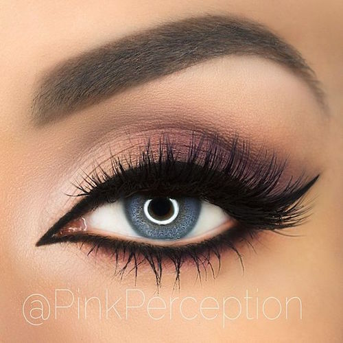 Soft plum smokey eye with black winged liner.