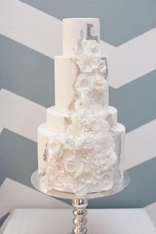 A silver background for the stunning cascade of white flowers marks the difference for this elegant wedding cake.