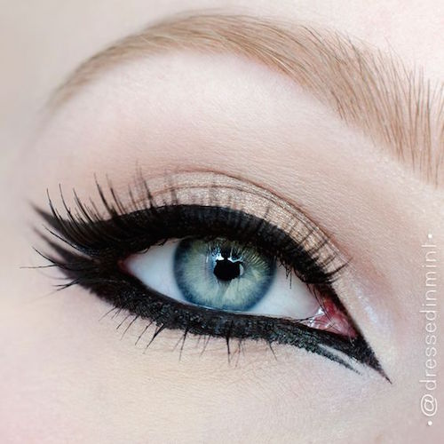Lots of drama for this double winged cat eye makeup.
