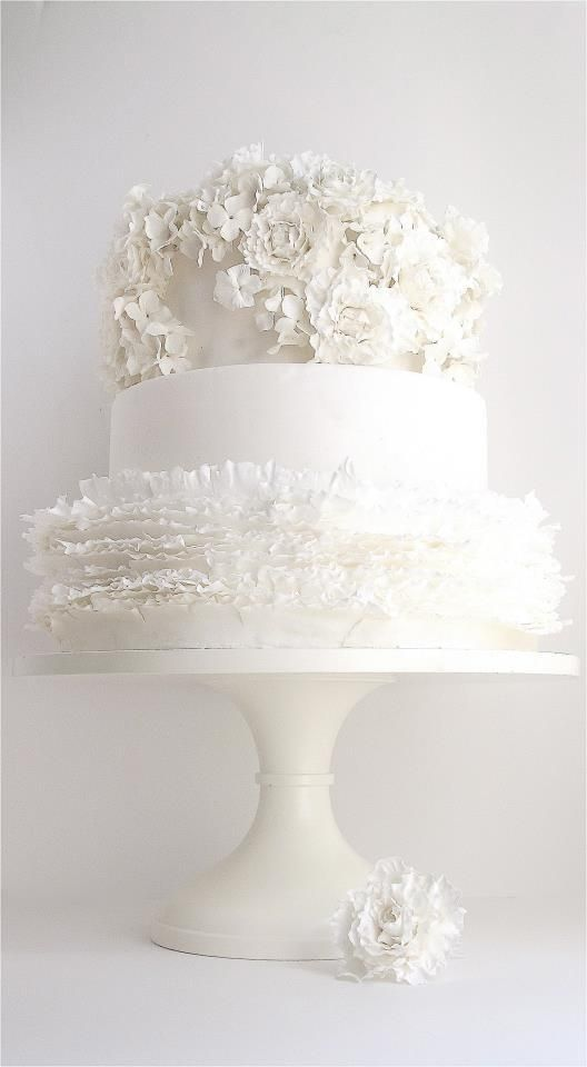 A creative and refreshing a Maggie Austin white wedding cake design.