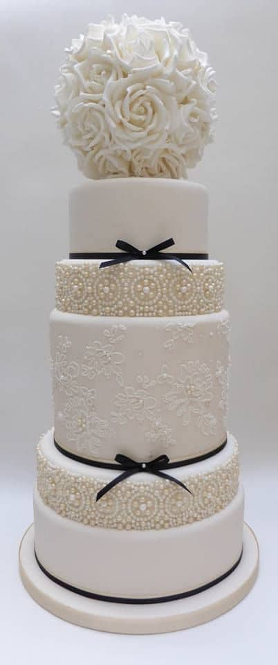The stunning simplicity of the white wedding cake.