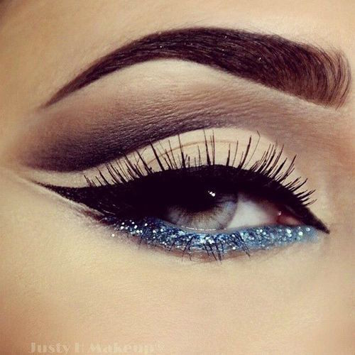 Winged cat eye with glitter on the lower lid. The eyes WILL say it all! :)