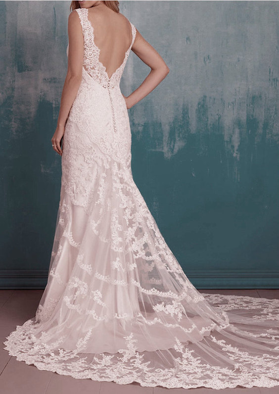 Backless mermaid lace wedding dress with short sleeves.