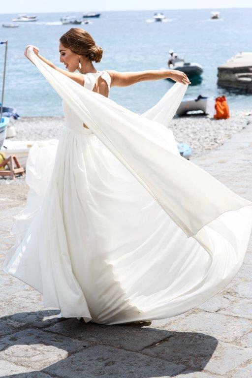 Beach wedding dress in chiffon by Mila Mira Bridal.