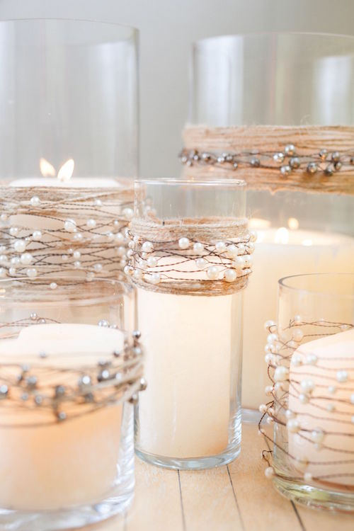 Candle wedding centerpieces decorated with pearl beads on wire garland with natural jute twine.