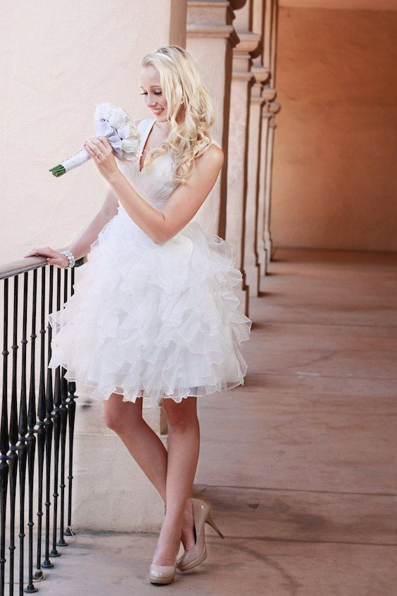 Modern and chic short wedding dress with straps for the reception or a garden wedding.