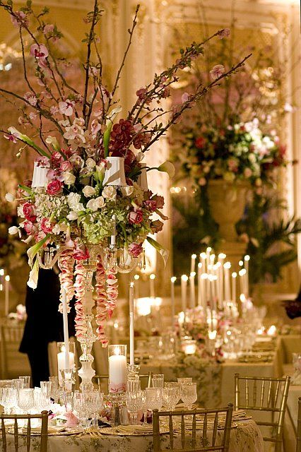 Tall floral wedding centerpieces by David Tutera.