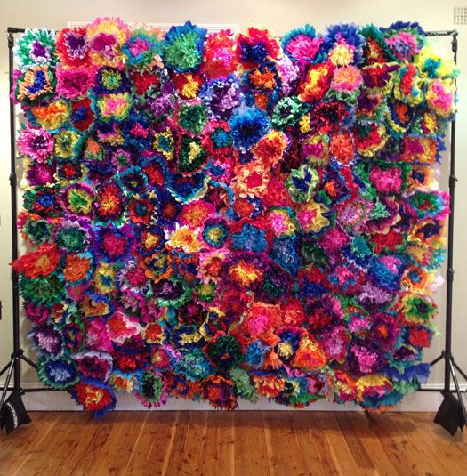 Mexican Fiesta backdrop for a photobooth with paper flowers.