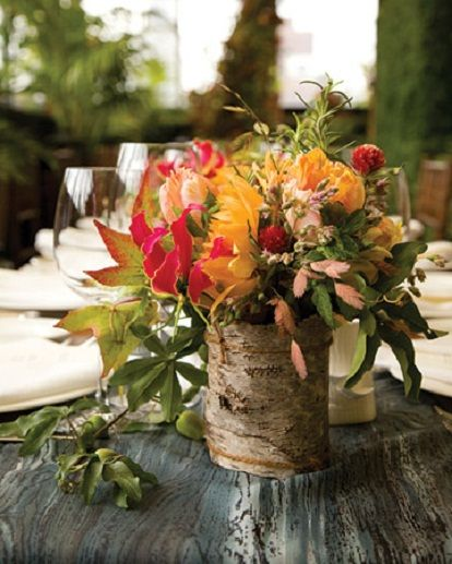 Give your centerpiece a rustic touch by covering the base with bark.
