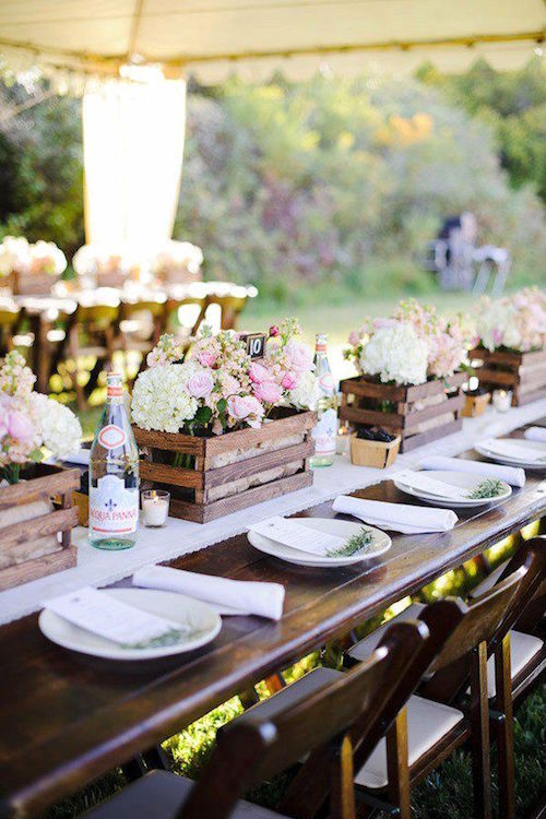 Love how the delicate blooms contrast against the country rustic wedding centerpieces.