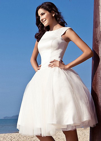 Our favorite Etsy wedding dress stores! Knee-length bateau neck ball gown dress in satin and tulle.