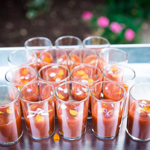 Late summer sips gazpacho soup shooters by Farm to Table Catering. Photography: Donna Beck Photography.