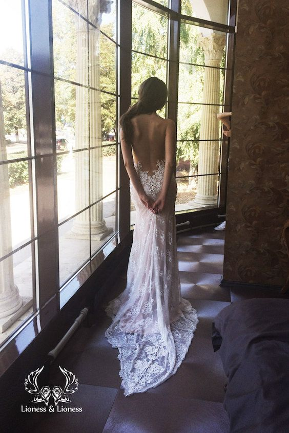 Sexy lace backless wedding dress. Love the details!