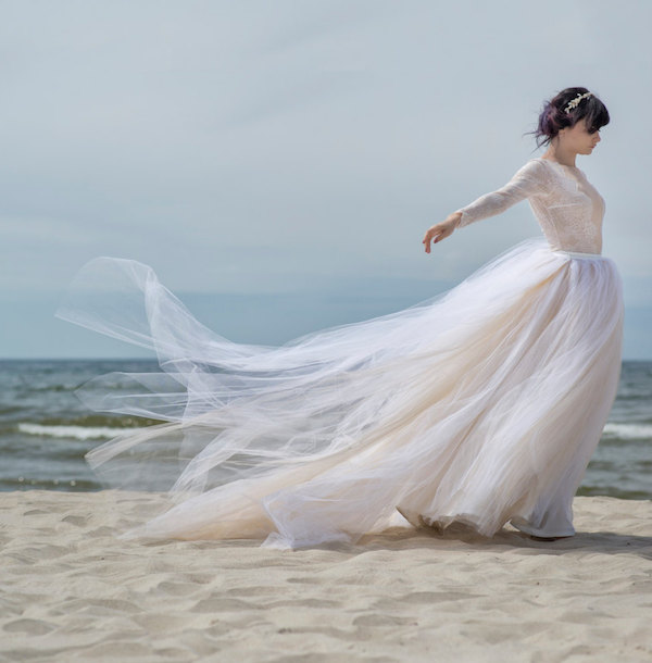 Dreamy tulle and lace rustic and romantic long sleeved wedding dress.