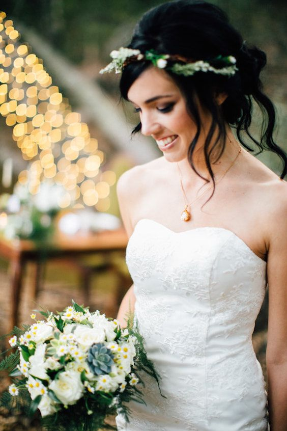 Fun and fitted lace mini ivory wedding dress with a sweetheart neckline.