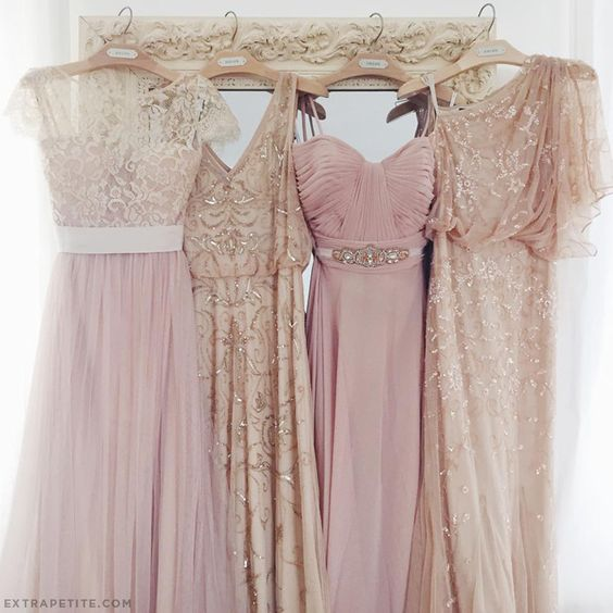 Mix and match bridesmaid dresses in tulle, beading, blush pink and champagne. Everything tied together with a common color theme.