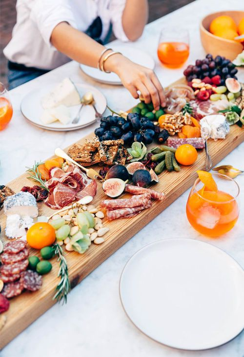 Love the originality of sustainable catering. Instead of presenting individual servings, a centerpiece with ethically sourced delicacies.