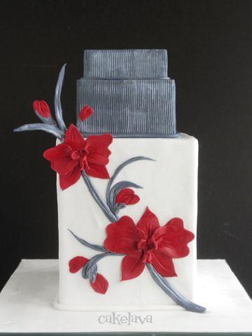 Un pastel de bodas en color gris y rojo de Cakelava.
