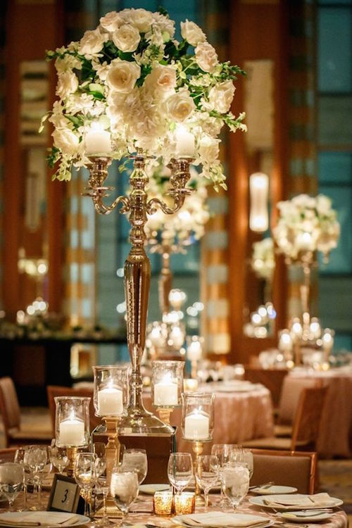 Stunning tall floral centerpiece for this Chicago wedding captured by Ann & Kam Photography.