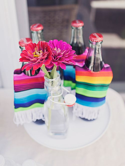 We love this wedding centerpiece shot styled by Little Miss Party Planner. Mexican Cokes dressed up in sarape cozies. Photography: Raquel Bianca.