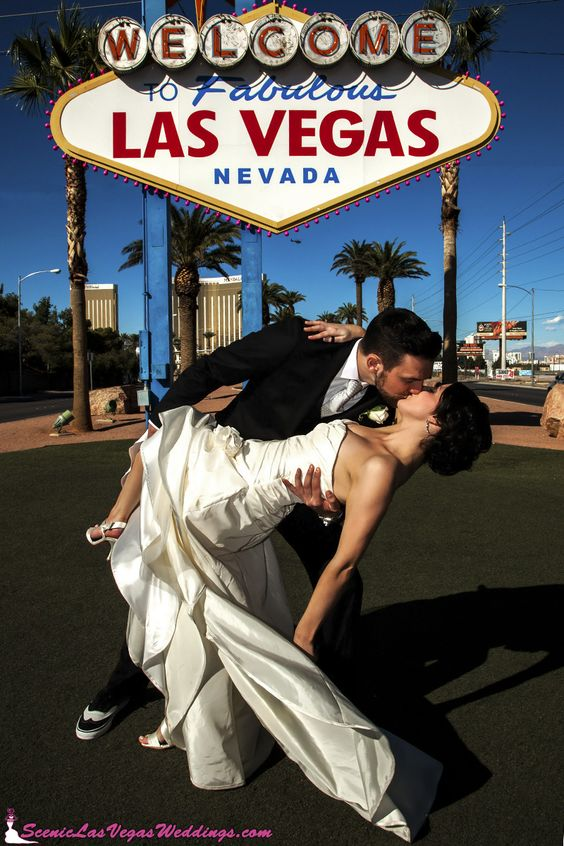 A dip at the Las Vegas sign. A must for your Las Vegas wedding photography. Do it at night when the lights are quite Vegas lit up. Photo credit: sceniclasvegasweddings.