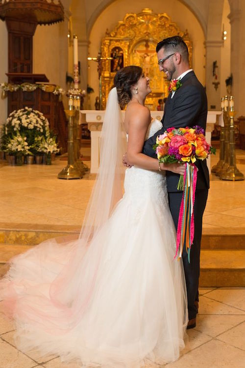 A bride with a gorgeous ombre veil at her Catholic wedding at the San Fernando Cathedral, San Antonio, Texas.