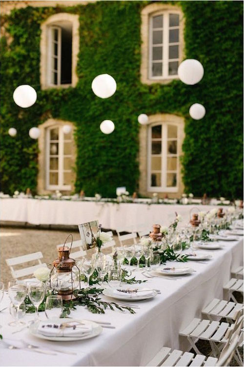 A few French wedding ideas with elegant sophistication. Copper lanterns, simple greenery and white table top and chairs. Rustic French wedding at Belle Vie de Chateau captured by Chris+Lynn Photographers.