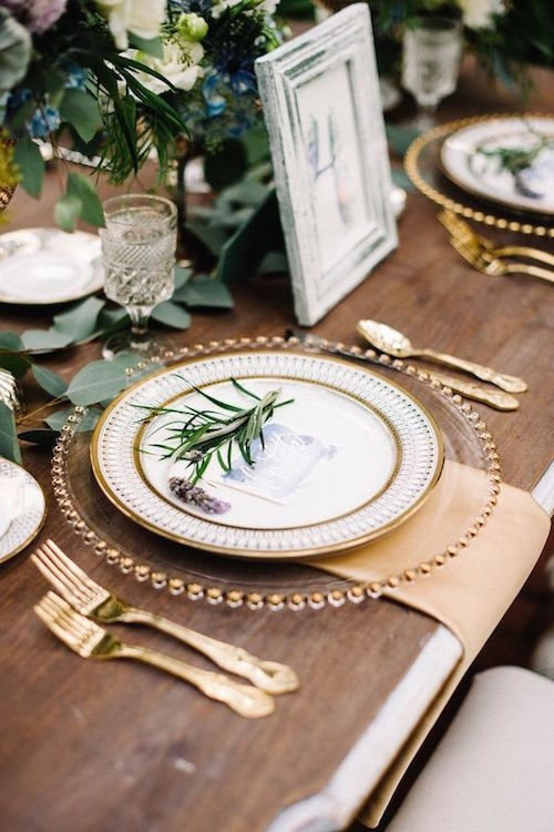 Chic modern wedding reception table setting in dusty blue and lavender on this French wedding inspired theme dripping with romantic details. Photo: Best Photography.