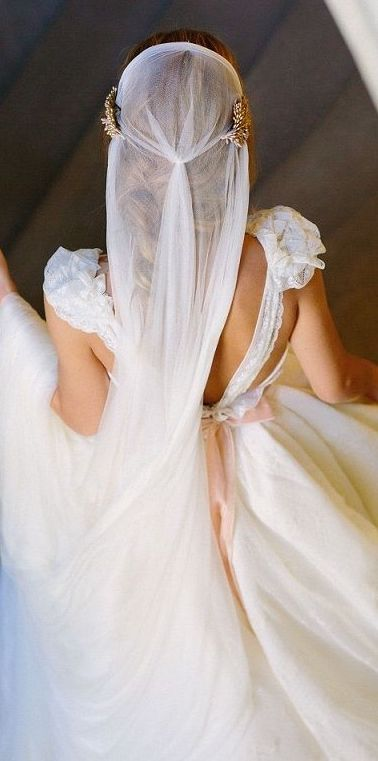 The elegance and simplicity of a Parisian wedding reflected on the bride's veil.